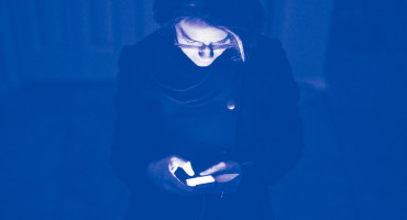 woman using smartphone in dark