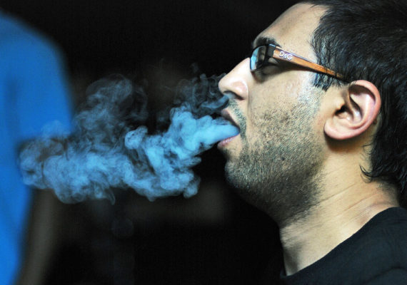 man smoking a hookah