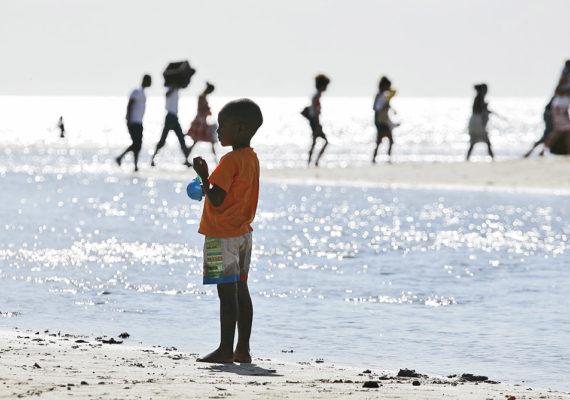boy stands on a beach