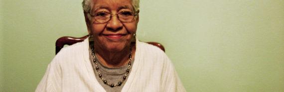 older woman, green wall
