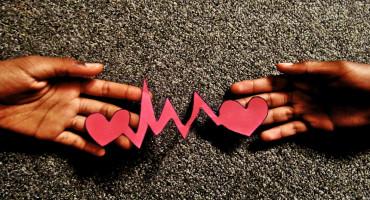 paper heartbeat between hands