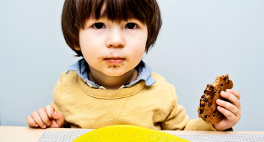 kid holds cookie - GFCF diet