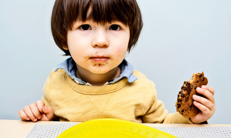 kid holds cookie - GFCF diet