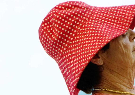 woman wears a red hat