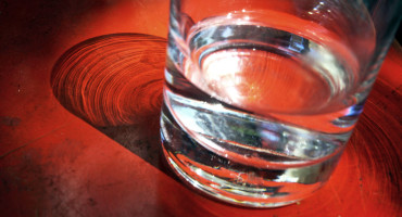 glass of water on red