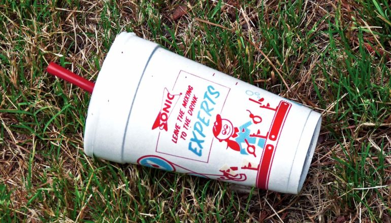 styrofoam cup on grass
