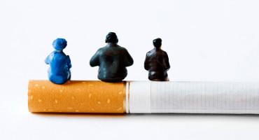 tiny figurines on cigarette
