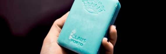 hand with blue bar soap