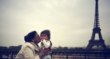 woman and child with Eiffel Tower in background