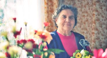 elderly Polish woman with flowers