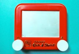 etch-a-sketch toy on blue