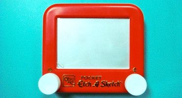 etch-a-sketch toy on blue