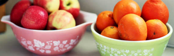 bowls of apples & oranges on counter