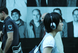 woman with headphones on a crowded street