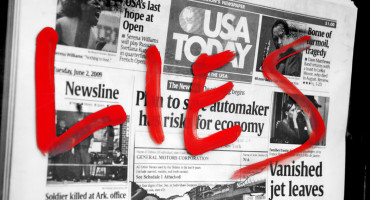 "red ""lies"" on newspaper"