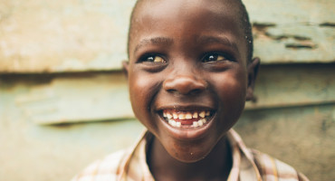 smiling boy from Uganda
