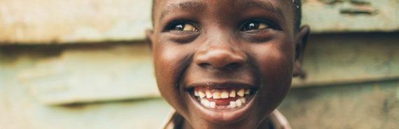 smiling boy from Uganda