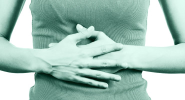 woman hands on stomach