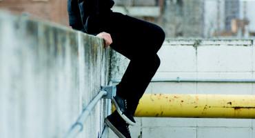 teen in black at skatepark