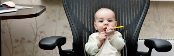 baby in office chair