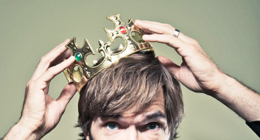 man puts on crown
