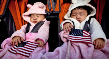 two babies with US flags