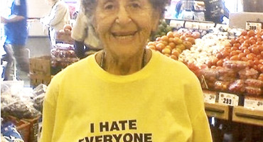 woman wears 'I hate everyone' sweatshirt