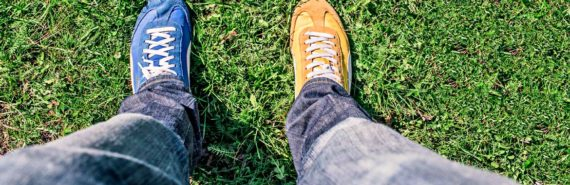 man's legs with sneakers