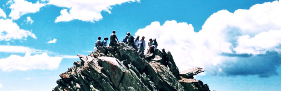 people on mountain - climate adaptation