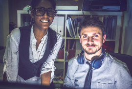 two people in dark office