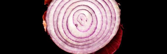 half a red onion on black