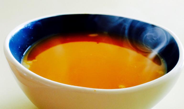 orange soup in blue bowl