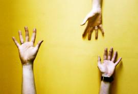 hand reaching on yellow - axons