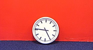 clock against a red wall