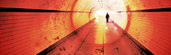 figure in red tunnel