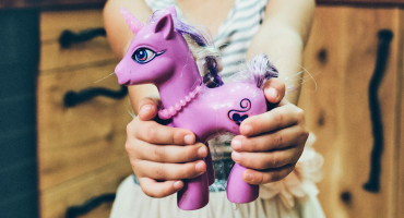 girl shares pony toy