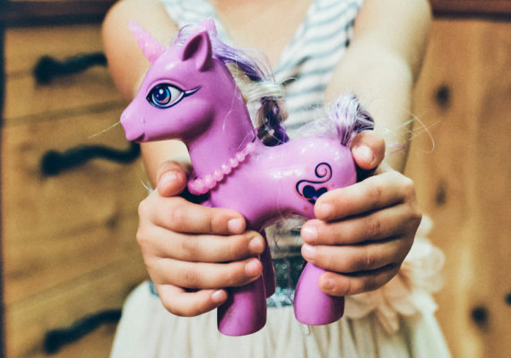 girl shares pony toy
