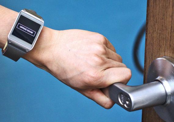 smartwatch user touches door