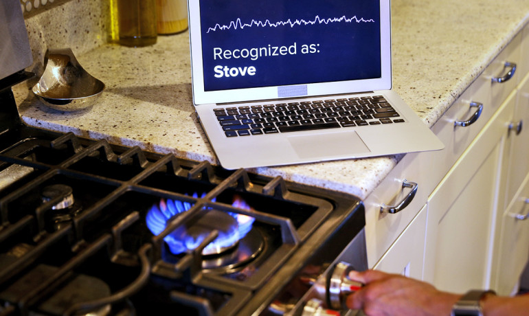 smartwatch user turns on stove
