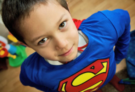 little boy in a superman costume