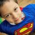 little boy in a superman costume
