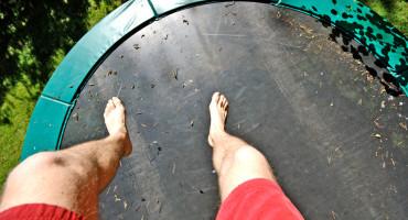 legs above trampoline
