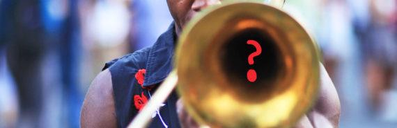 man plays trombone