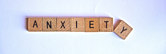 """scrabble letters spell """"anxiety"""""""