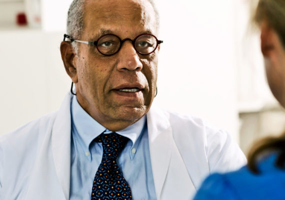 physician talks to patient