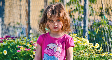 little girl in ice cream t-shirt