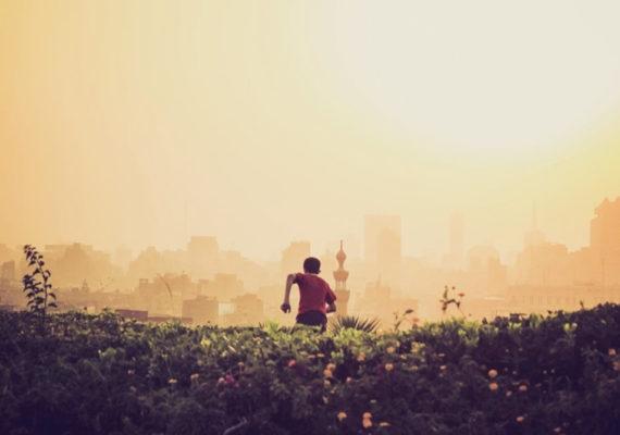 child runs away toward city