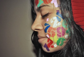 woman with numbers painted on her face