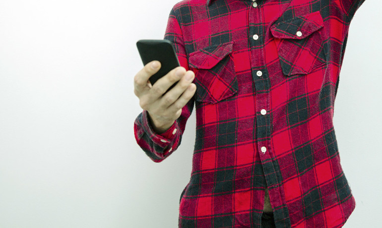 man holds a smartphone