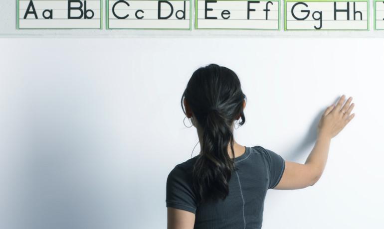 teacher uses interactive board